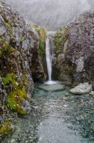 There were many waterfalls on th climb up to Harman Pass .